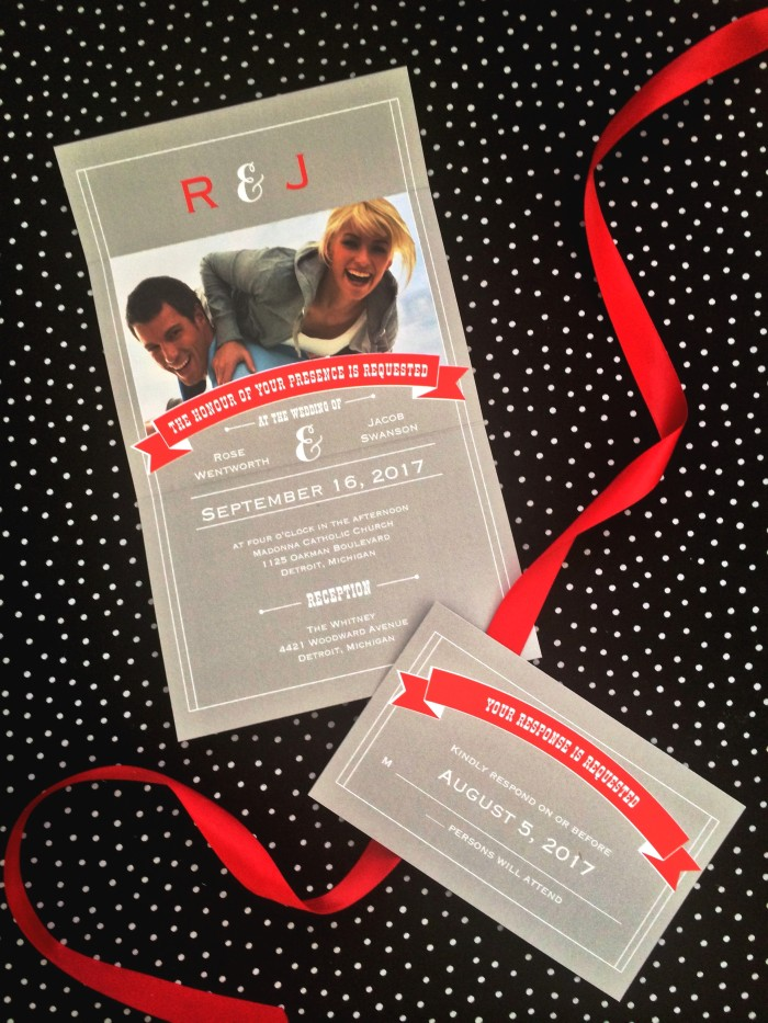 gray invitation with red ribbon