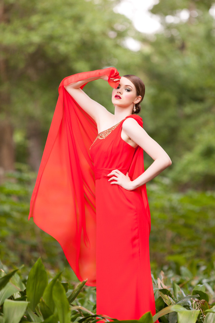 Stunning red gown from Solutions Bridal Design House  Photography