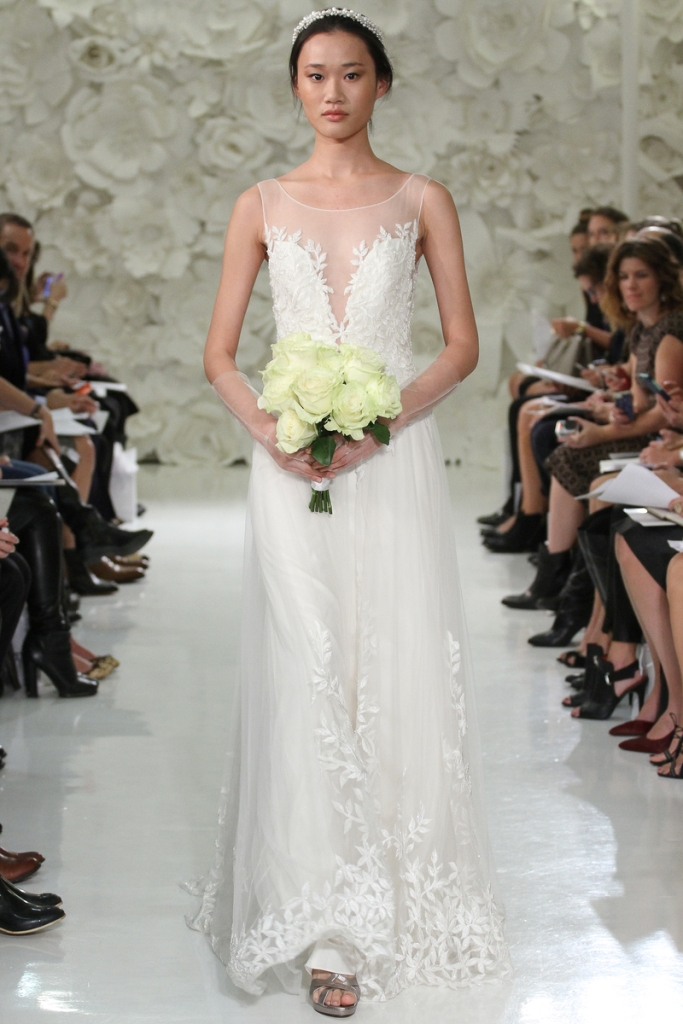Watters style 7083B Lalai Ivory bridal gown, with A-line skirt, beaded wedding dress with plunging neckline.