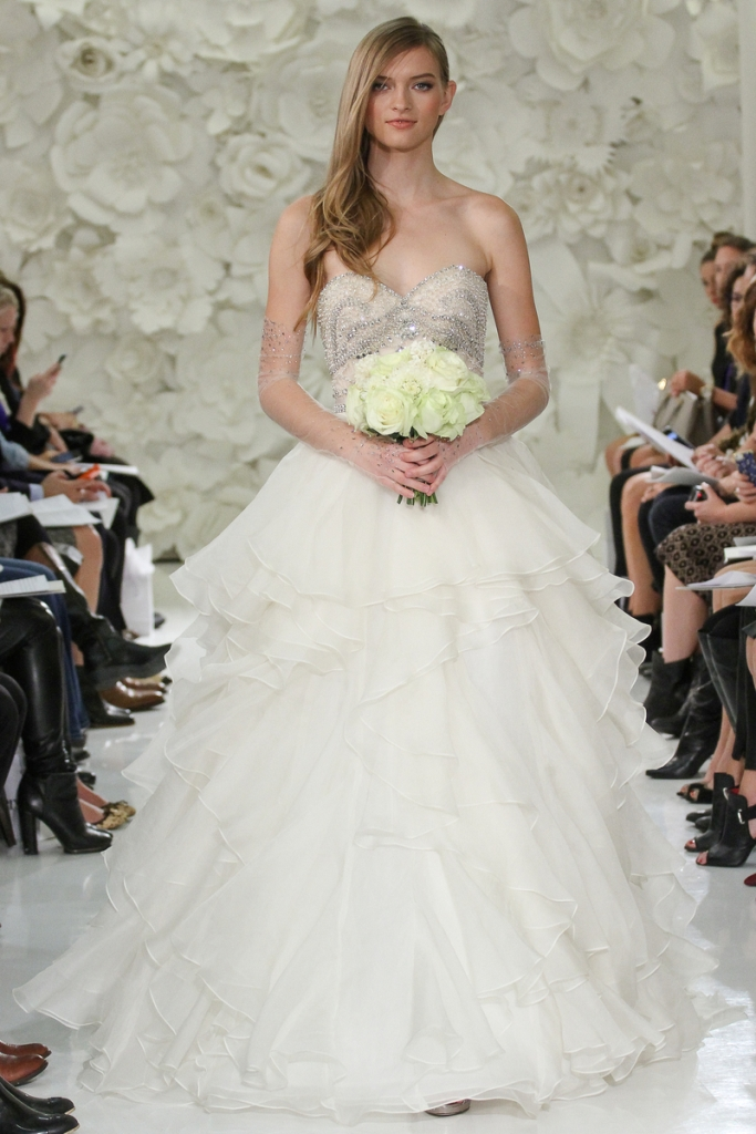 Model walks runway in a Watters Brides gown, by Vatana Watters, for the Watters Spring 2015 bridal fashion, at the Couture Show, during New York Bridal Fashion Week Spring 2015.