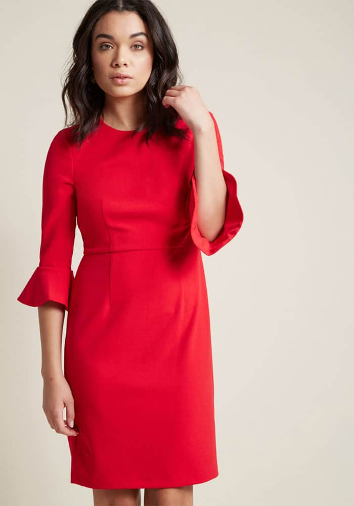 Red holiday dress with ruffled sleeve