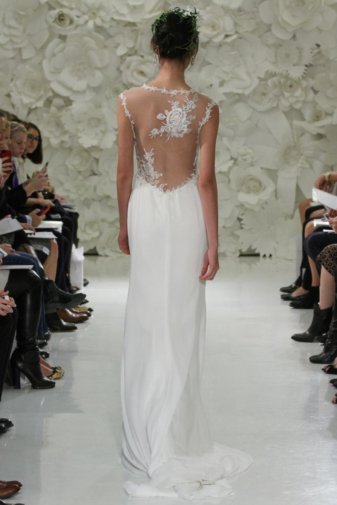 Model walks runway in a bridal gown from the Love Marley Spring 2015 Whimsical Forest collection, by Vatana Watters, for the Watters Spring bridal fashion, at the Couture Show, during New York Bridal Fashion Week Spring 2015.