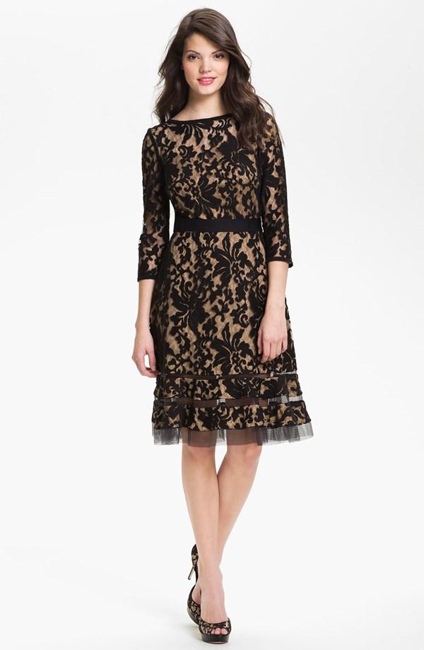 Cocktail length black lace gown