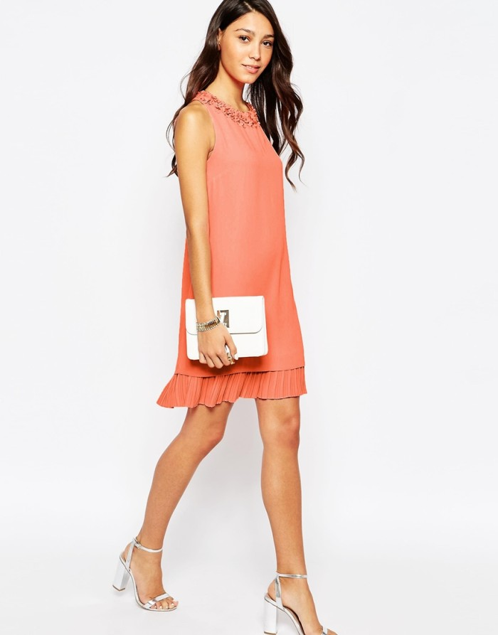 Coral dress with pleated hem