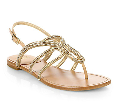 gold sandals for a beach wedding