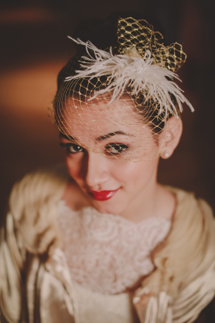 Gold birdcage veil by Hushed Commotion handmade bridal accessories. Photography by Chellise Michael