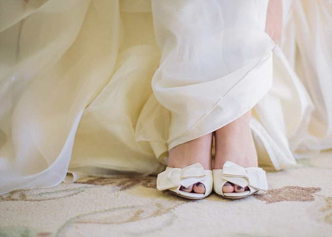 Ivory bow bridal shoes by kate spade new york | Photography by Kelly Sauer