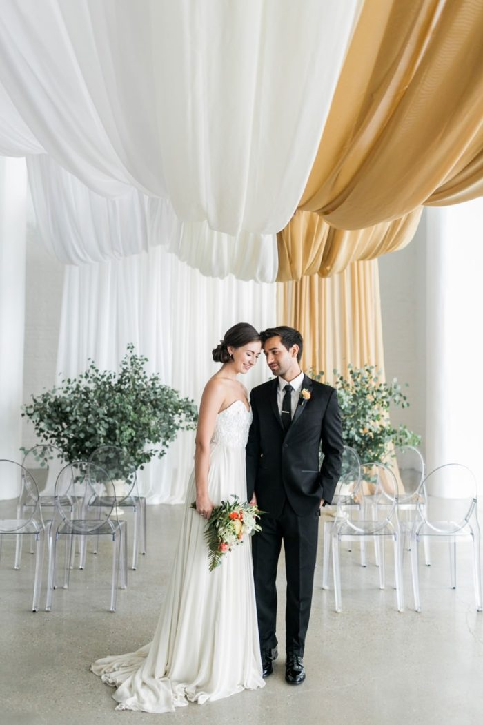 Aisle Society | Bride and groom under draping | Photographer ©Alexis June Weddings