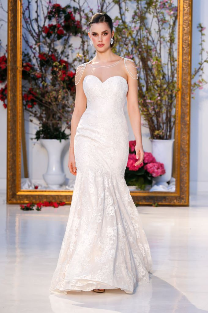strapless wedding dress by Anne Barge with shoulder jewelry