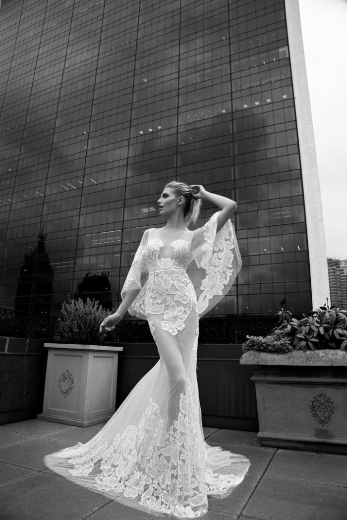 Sheer flutter sleeve couture bridal gown