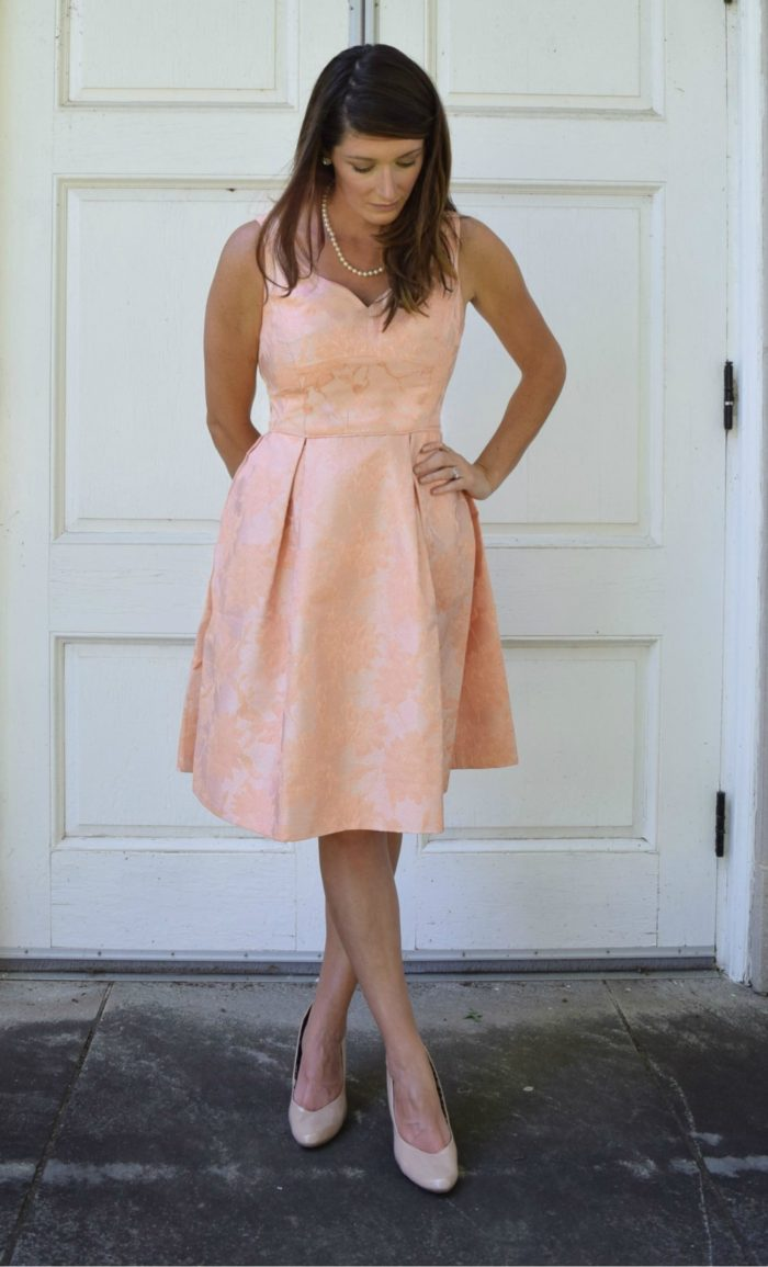 Peach fit and flare semi formal wedding guest dress | Showing the 'Stylish Serendipity' dress from ModCloth