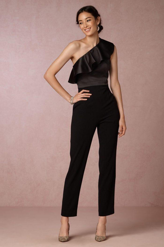 One shoulder black ruffle jumpsuit   Black tie wedding jumpsuit