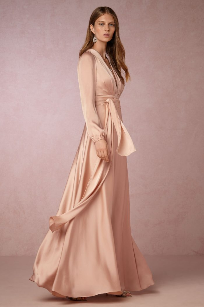 Satiny blush long sleeve gown