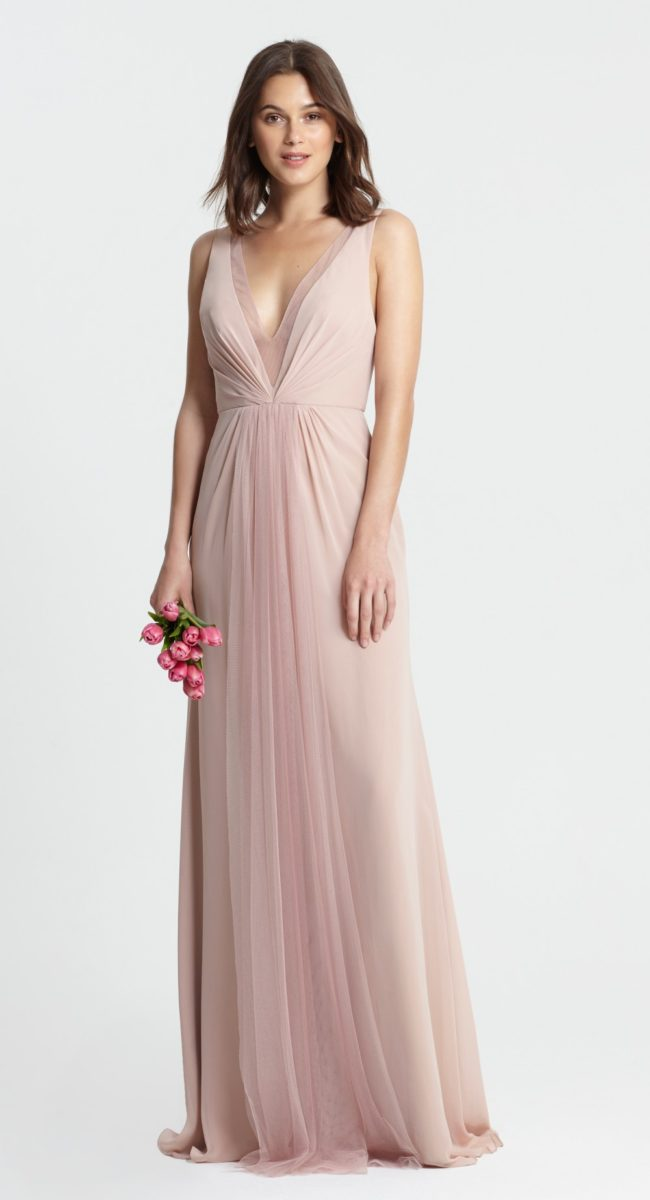 Shell pink bridesmaid dress with deep neckline by Monique Lhuillier