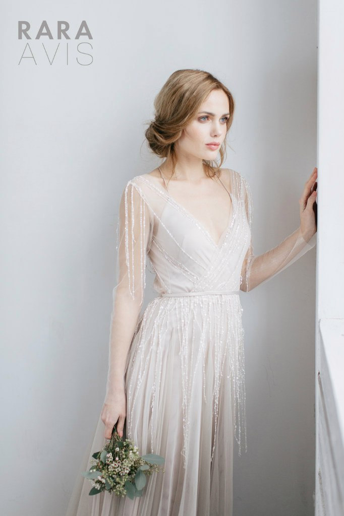 Long sleeve sheer wedding gown by Rara Avis