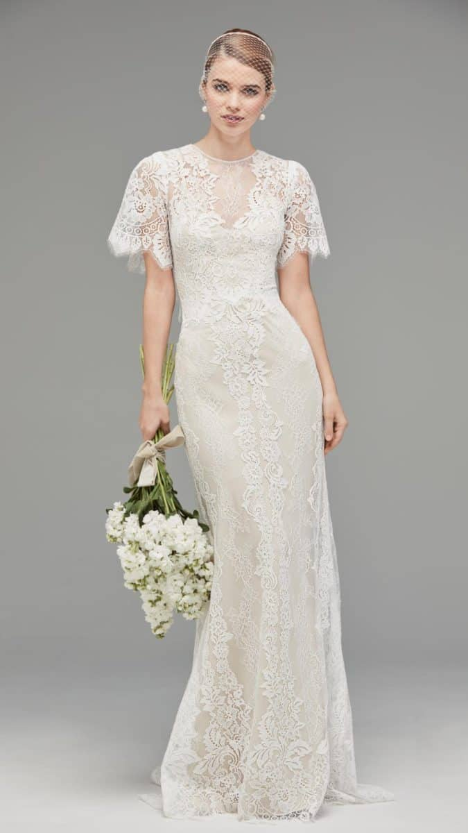 Lace wedding dress with flutter sleeve, capelet