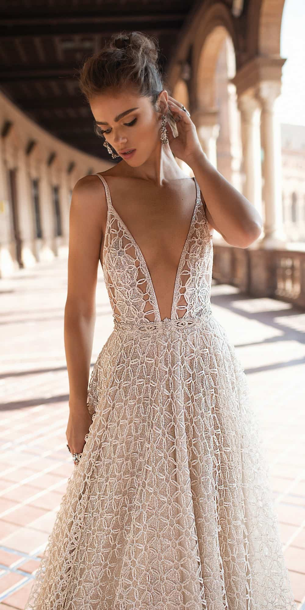 sheer embellished wedding dress with plunging neckline by berta bridal