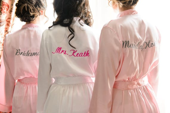 Robes with names on back for bridesmaids