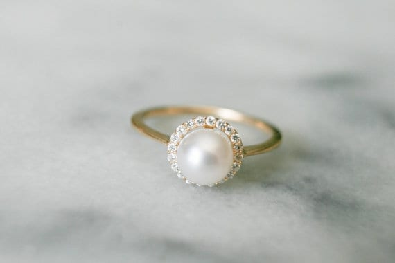 pearl halo engagement ring