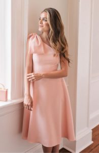pink one shoulder dress for a wedding with bow