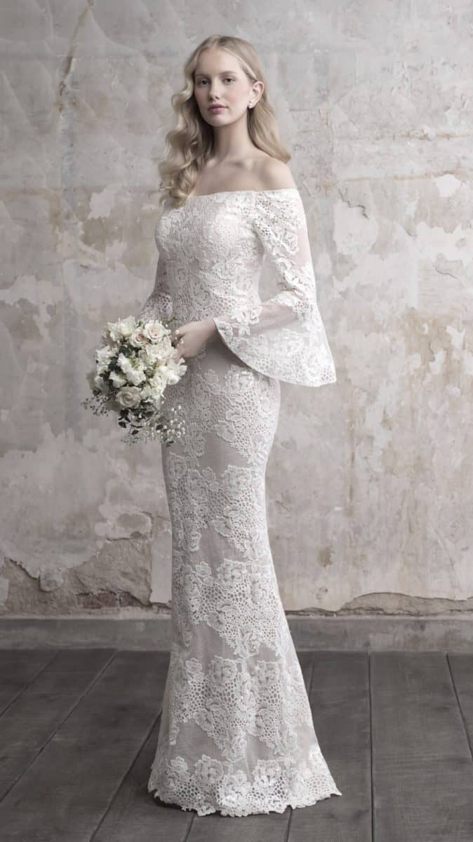 Lace wedding dress with unique off the shoulder style and bell sleeves by Madison James