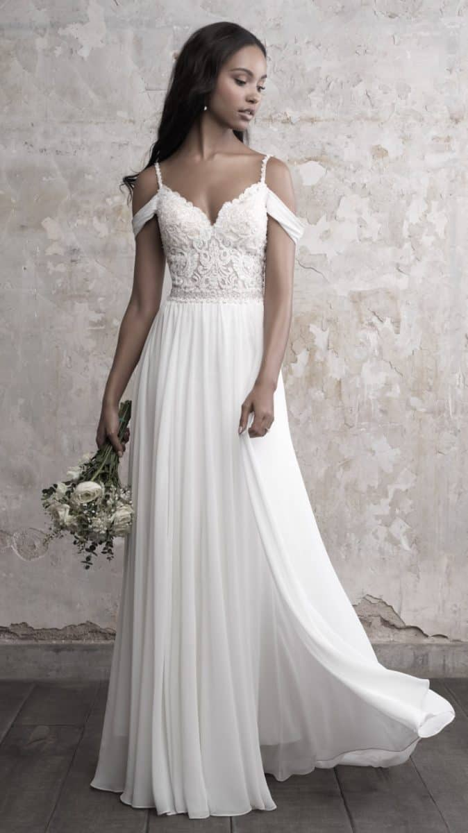 Cold shoulder wedding dress with spaghetti straps by Madison James
