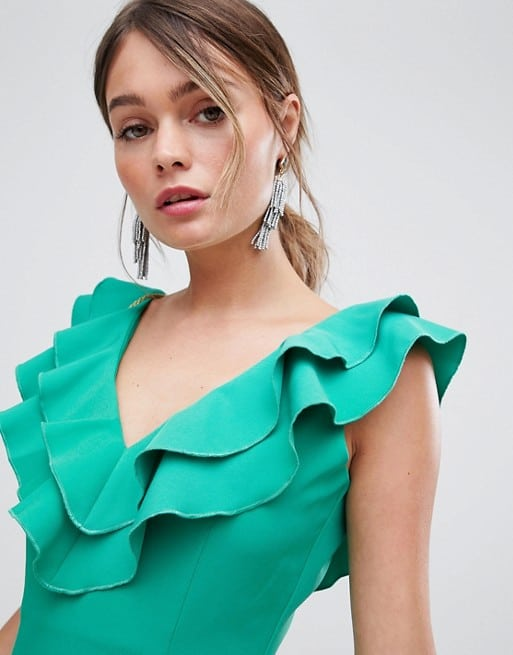 cf682ed6cd This pretty green ruffled gown is great for any semi-formal dress code!  This pretty color is a fabulous cool tone to combat summer heat!
