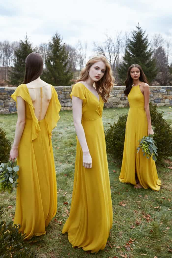 Yellow bridesmaid dresses with flutter sleeves by Jenny Yoo