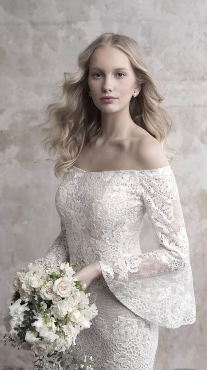 Madison James wedding dress with off the shoulder neckline and long bell sleeves