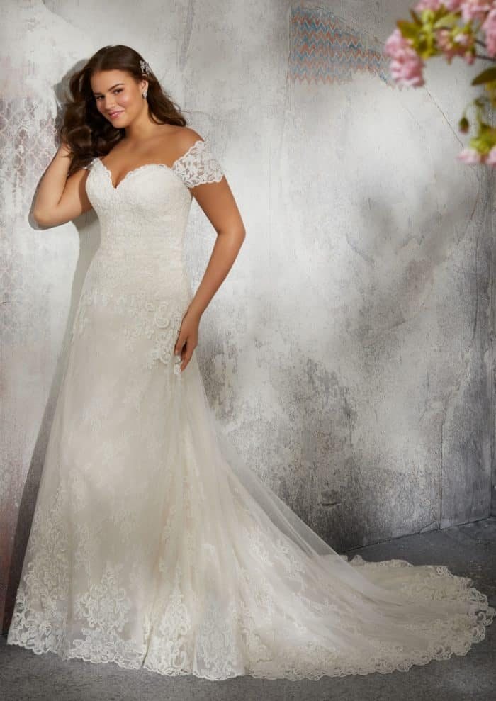 Off the shoulder cap sleeve lace wedding dress in plus sizes