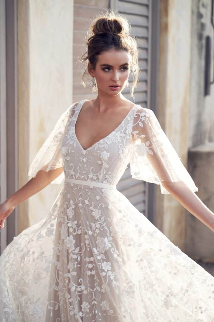 Sheer draped sleeve bridal gown by Anna Campbell