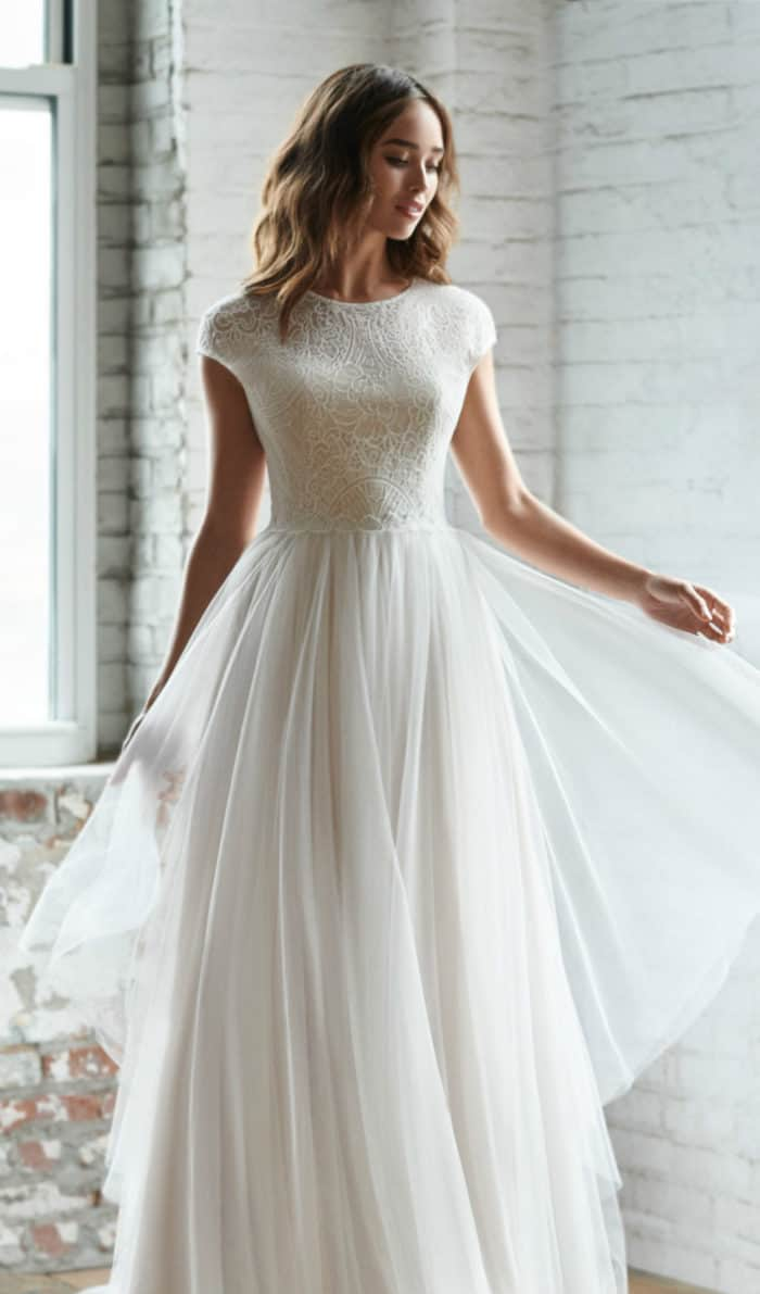 Lace cap sleeve and tulle wedding dress under 2000 | Riva Ti Adora Fall 2018