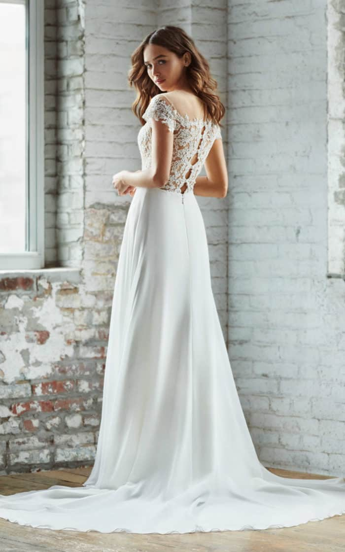 Adeline a sheer lace bodice wedding dress by Ti Adora