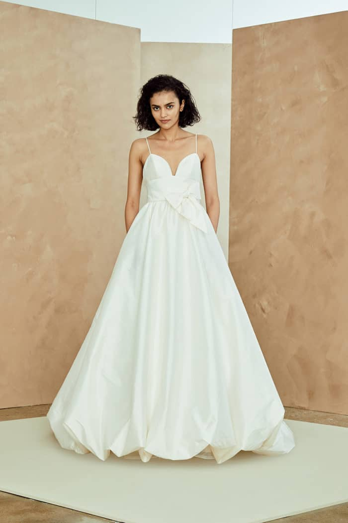 Ballgown wedding dress with a bow and thing straps Nouvelle Amsale