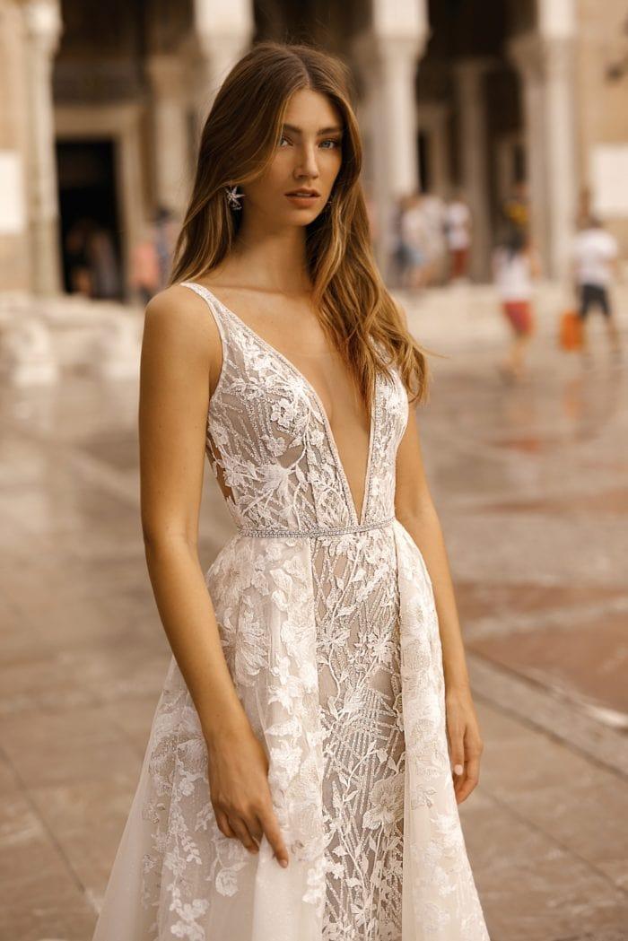 Designer wedding dress with overskirt