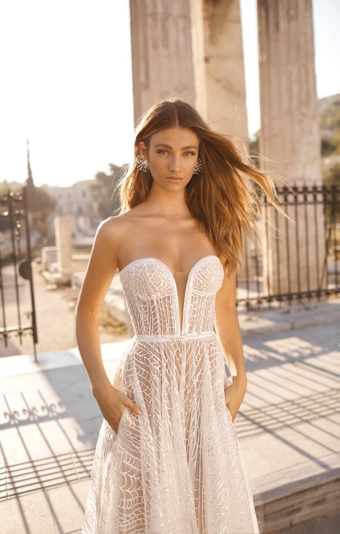 Sheer strapless bridal gown with plunging neckline