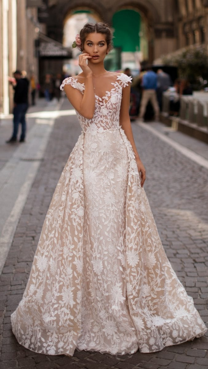 Beautiful lace wedding dress with overskirt