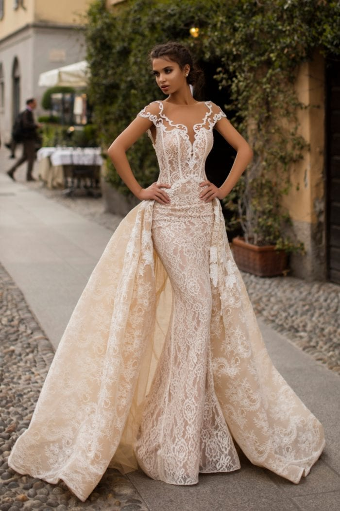 Off white lace gown with overskirt