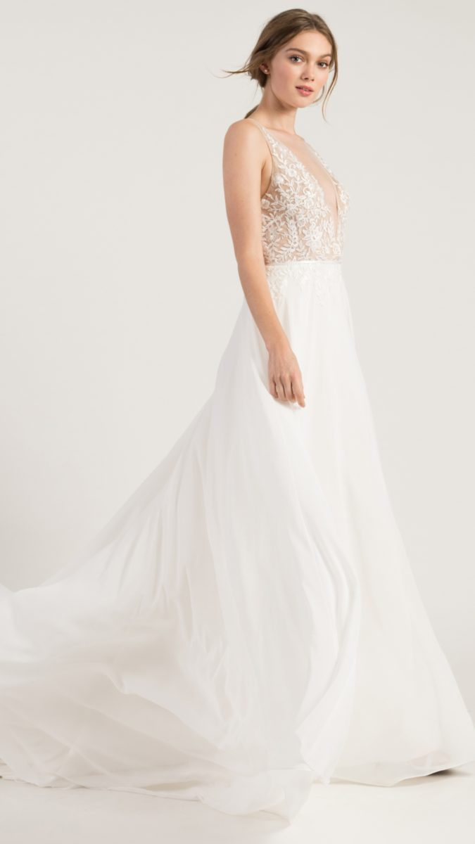 A line wedding dress with lace top and spaghetti straps and flowy skirt