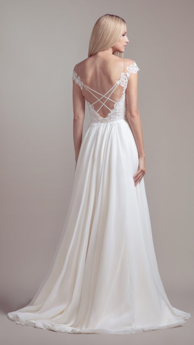Strappy back wedding dress with cap sleeves