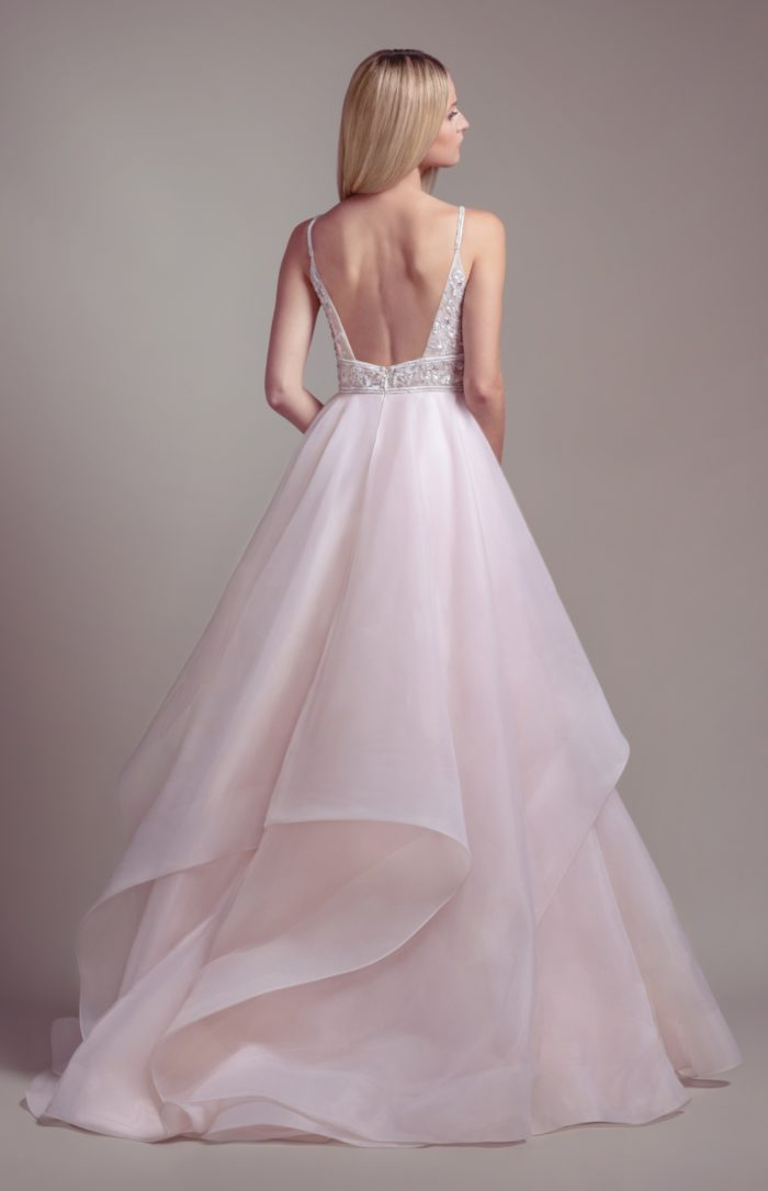 Blush wedding dress with tulle and organza ball gown and beaded bodice