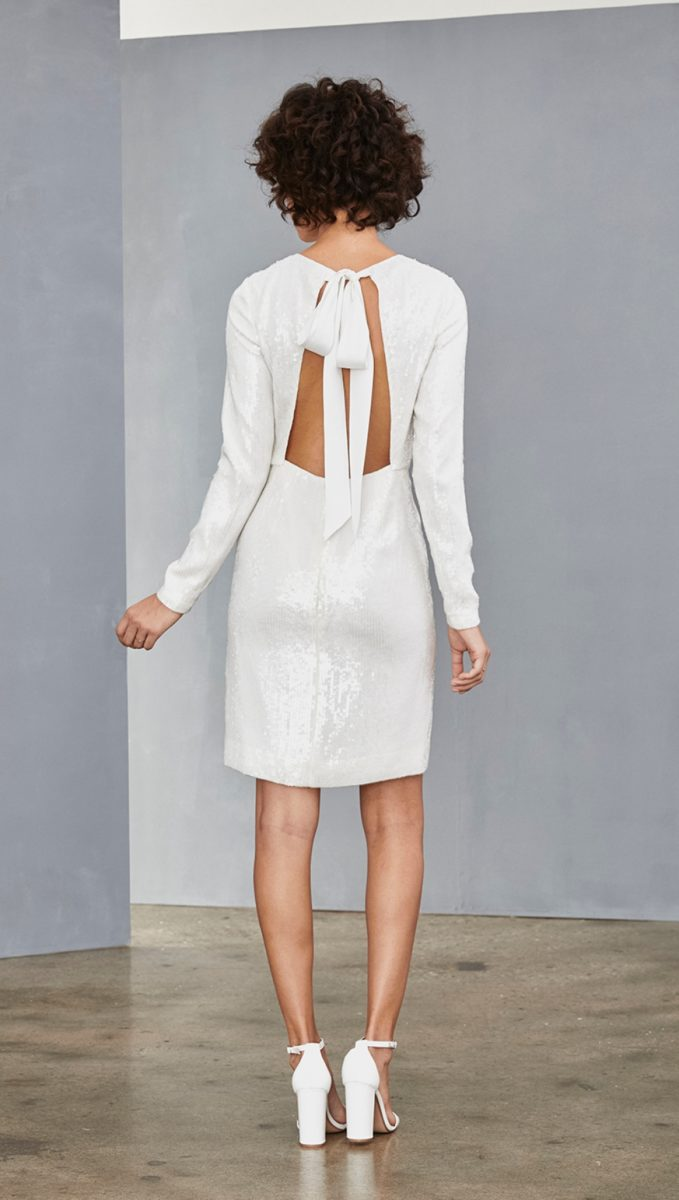 Bow back white sequin shift dress with long sleeves | Amsale Little White Dress Collection