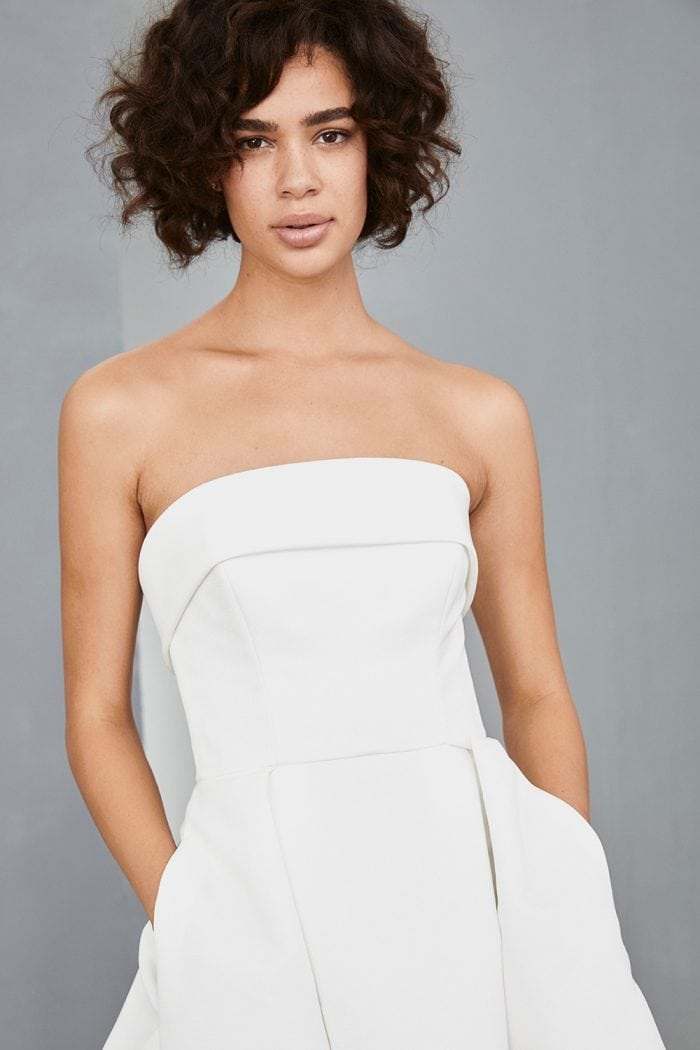 Short white strapless dress with pockets and full skirt