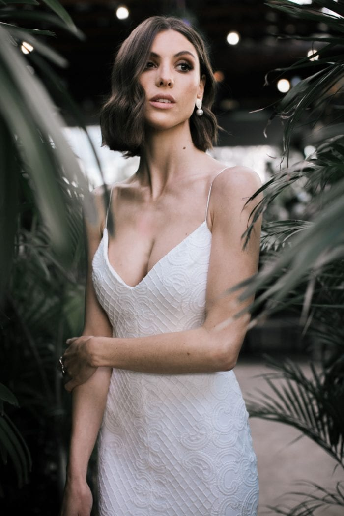 Lace wedding dress with spaghetti straps by Karen Willis Holmes