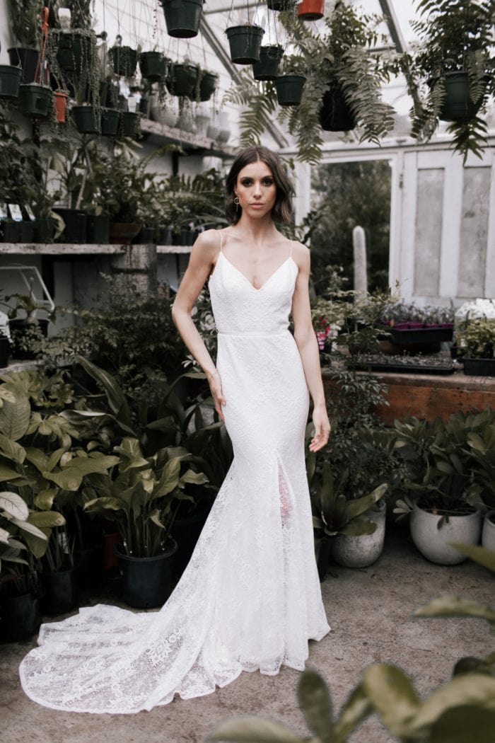 Justine is lace overlay spaghetti strap wedding dress.
