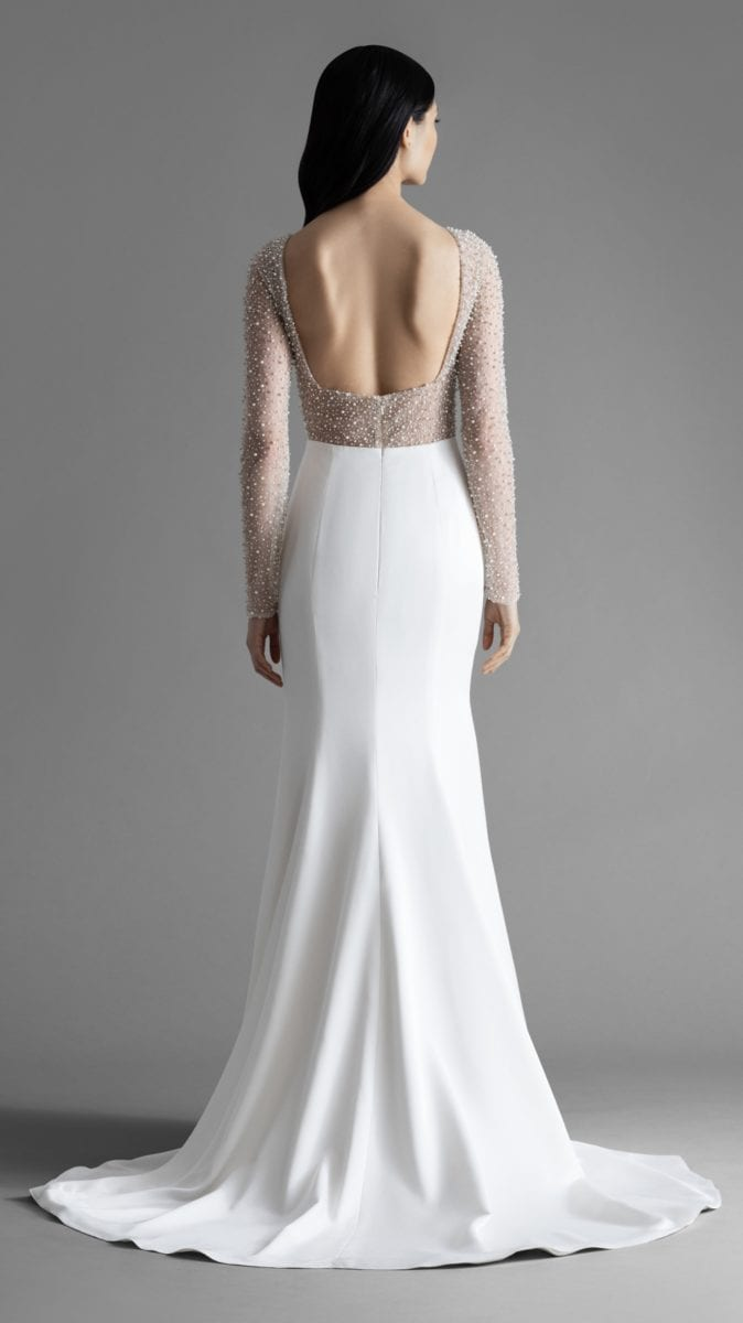 Back detail of Alexa gown by Allison Webb. Long sleeve modern wedding dress with embellished sleeves and bodice