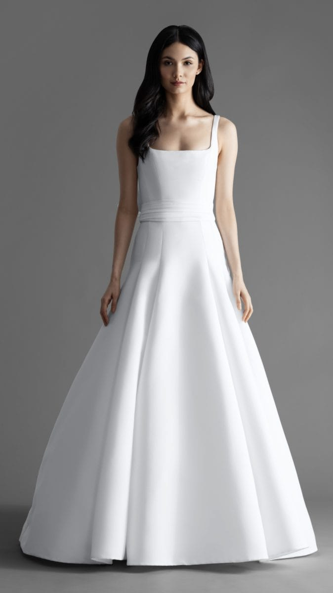 Easton is a curved square neck wedding dress with wide straps and optional bow