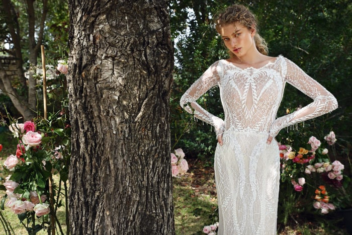Style G209 Body-hugging mermaid lace wedding dress has sheer sides and long sleeves