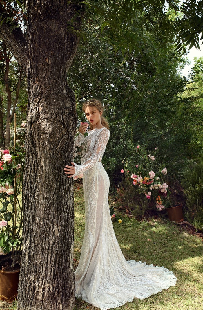 Sheer panel long sleeve wedding dress with bateau neckline