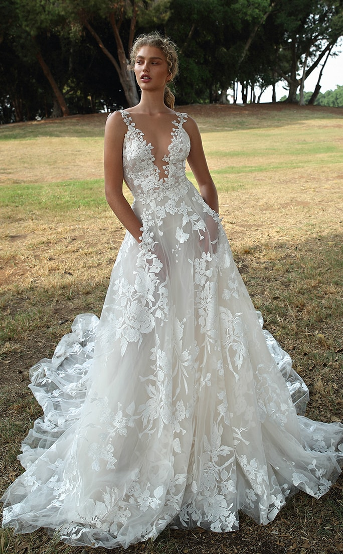 Sheer lace v neck bridal gown with pockets